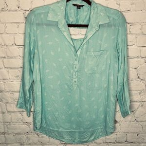 American Eagle mint green top with back cut out